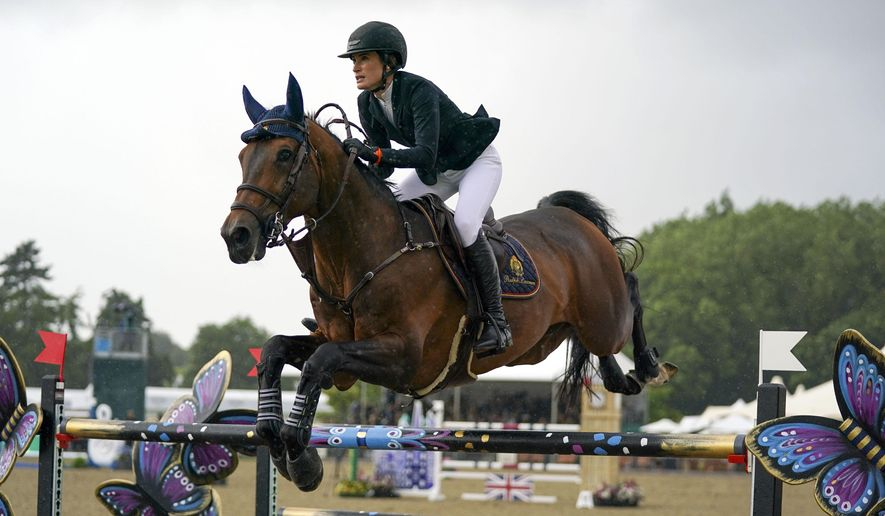 USA's Jessica Springsteen riding Don Juan van de Donkhoeve competes in the Rolex Grand Prix at the Royal Windsor Horse Show, in Windsor, England, Sunday July 4, 2021. (Steve Parsons/PA via AP)