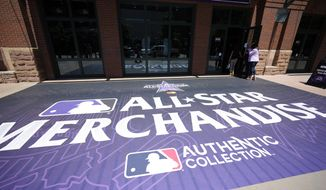 Shoppers head into Diamond Dry Goods, the team store for the Colorado Rockies at Coors Field, past a sidewalk sign advertising All-Star Game merchandise after a news conference Wednesday, July 7, 2021, to kick off All-Star week in Coors Field in Denver. (AP Photo/David Zalubowski) **FILE**