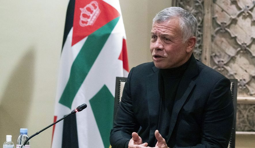 In this May 26, 2021, photo, Jordan's King Abdullah II speaks during a meeting with Secretary of State Antony Blinken at Bayt Al Urdon in Amman, Jordan. President Joe Biden will host Jordan's King Abdullah II at the White House on July 19, months after the detention of his half-brother amid a rare moment of palace intrigue for the close American ally. (AP Photo/Alex Brandon, Pool) **FILE**