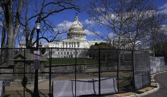 In this April 2, 2021, file photo the U.S. Capitol is seen behind security fencing on Capitol Hill in Washington. The fencing installed around the Capitol after the deadly Jan. 6 insurrection will start being removed as soon as Friday, July 9, but most visitors are still not allowed inside the iconic building. (AP Photo/Carolyn Kaster, File)  **FILE**
