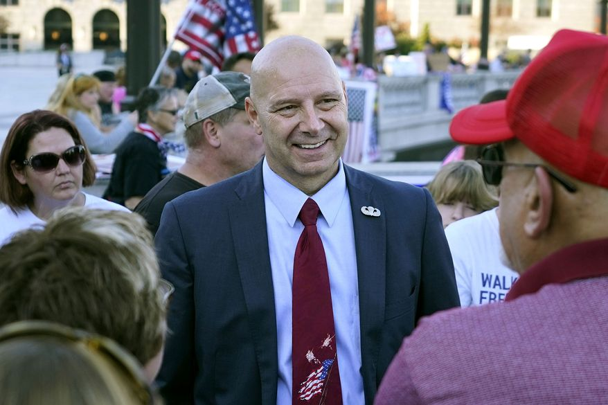 """In this Nov. 7, 2020, photo, Pennsylvania state Sen. Doug Mastriano, R-Franklin, center, speaks to supporters of President Donald Trump as they demonstrate outside the Pennsylvania State Capitol in Harrisburg, Pa., after Democrat Joe Biden defeated Trump to become 46th president of the United States. Mastriano, said in a statement Wednesday, July 7, 2021, that, as chair of the Senate Intergovernmental Operations Committee, he issued letters to several counties, requesting """"information and materials needed to conduct a forensic investigation of the 2020 General Election and the 2021 Primary."""" (AP Photo/Julio Cortez) **FILE**"""