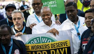 Brooklyn Borough President and a Democratic mayoral candidate Eric Adams smiles as participants gather for a march through the financial district during a parade honoring essential workers for their efforts in getting New York City through the COVID-19 pandemic, Wednesday, July 7, 2021, in New York. The parade kicked off at Battery Park and travel up Broadway in lower Manhattan, the iconic stretch known as the Canyon of Heroes, which has hosted parades honoring world leaders, celebrities and winning sports teams. (AP Photo/John Minchillo)