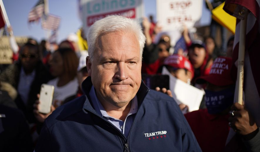 Matt Schlapp, chairman of the American Conservative Union, leaves after speaking at a news conference outside of the Clark County Election Department, Sunday, Nov. 8, 2020, in North Las Vegas. (AP Photo/John Locher)