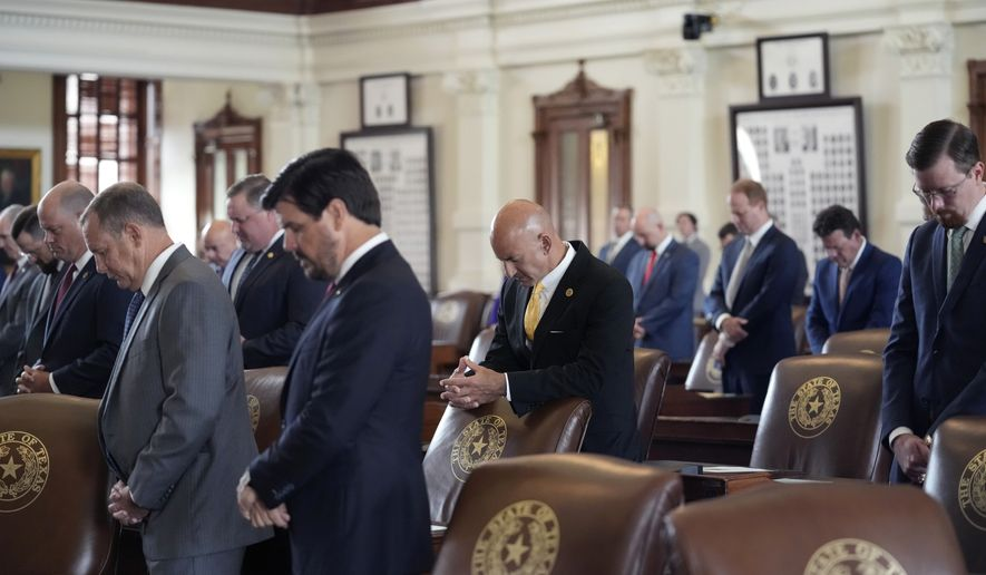 Members of the Texas House stand for a prayer as the House begins a special session, Thursday, July 8, 2021, in Austin, Texas. (AP Photo/Eric Gay) ** FILE **