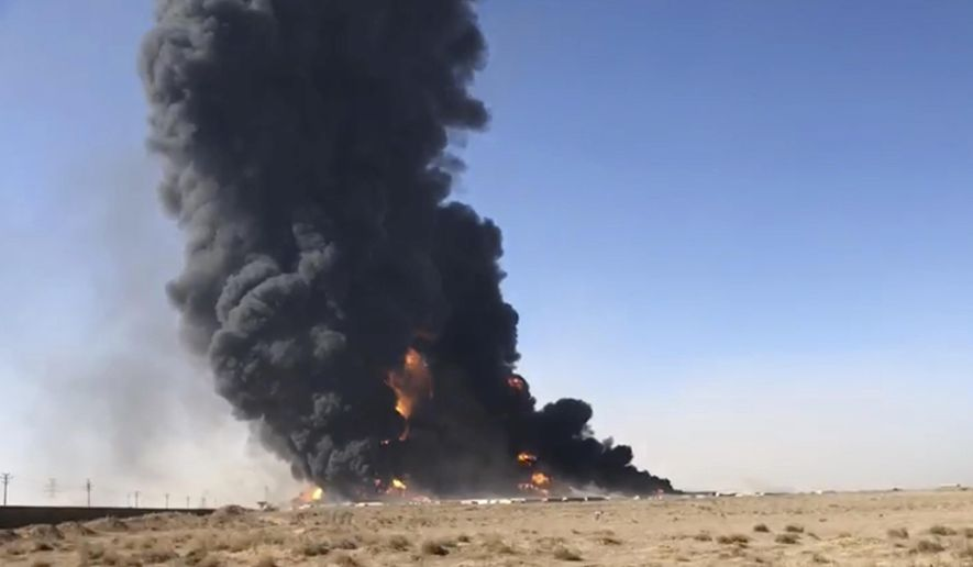 In this Saturday, Feb. 13, 2021, still image taken from video, smoke rises from fuel tankers at the Islam Qala border with Iran, in Herat Province, west of Kabul, Afghanistan. Taliban have taken control of Islam Qala crossing border in western Herat province at the neighboring Iran, an Afghan official and Iranian media confirmed on Thursday, July 8. (AP Photo) **FILE**