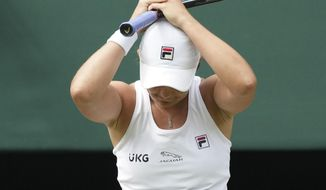 Australia's Ashleigh Barty celebrates after defeating Germany's Angelique Kerber in the women's singles semifinals match on day ten of the Wimbledon Tennis Championships in London, Thursday, July 8, 2021. (AP Photo/Alberto Pezzali)