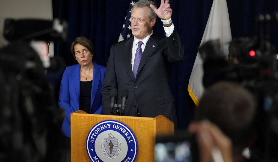 Massachusetts Gov. Charlie Baker, center, faces reporters as Mass. Attorney General Maura Healey, left, looks on during a news conference, in Boston, Thursday, July 8, 2021.