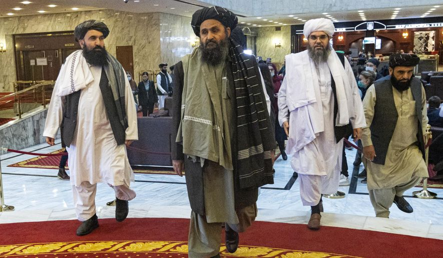In this file photo taken on Thursday, March 18, 2021, Taliban co-founder Mullah Abdul Ghani Baradar, center, arrives with other members of the Taliban delegation for an international peace conference in Moscow, Russia. A delegation of the Taliban visited Moscow on Thursday, July 8, 2021 to offer assurances that their quick gains in Afghanistan don't threaten Russia or its allies in Central Asia. (AP Photo/Alexander Zemlianichenko, Pool, File)