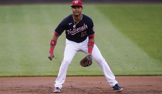 Washington Nationals third baseman Starlin Castro waits for a pitch to the Los Angeles Dodgers during the second inning of a baseball game, Friday, July 2, 2021, in Washington. (AP Photo/Julio Cortez)