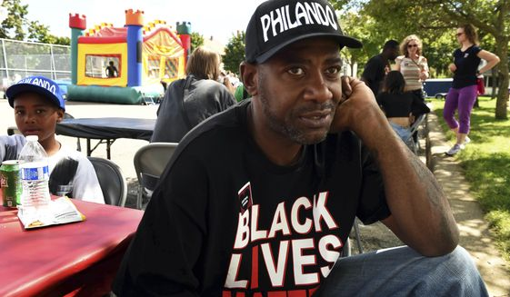 This Aug. 21, 2016 photo shows John Thompson, now a state representative, at a fundraiser at Central High School in St. Paul, Minn.  Thompson, who was ticketed for a driver's license violation is alleging he was racially profiled. The citation says State Rep. John Thompson of St. Paul, who is Black, presented a Wisconsin license during a traffic stop in St. Paul Sunday, July 4, 2021 .  (Scott Takushi/Pioneer Press via AP)