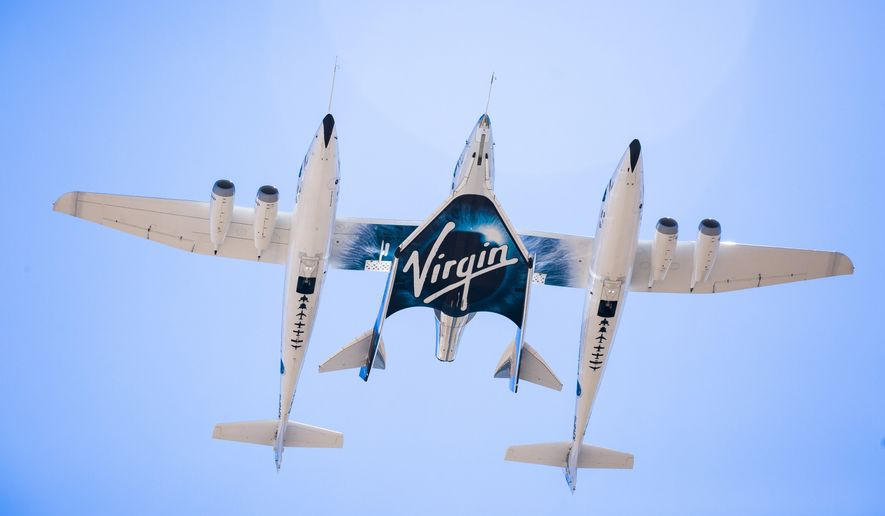 This Sept. 8, 2016 photo made available by Virgin Galactic shows the company's Spaceship Unity and Mothership Eve. After reaching nearly 50,000 feet (15,000 meters), Unity will be released and drop for a moment or two before its rocket motor ignites to send the craft on a steep climb toward space. (Virgin Galactic via AP)