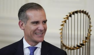 Los Angeles Mayor Eric Garcetti arrives for an event to honor the 2020 World Series champion Los Angeles Dodgers baseball team at the White House, Friday, July 2, 2021, in Washington. (AP Photo/Julio Cortez)