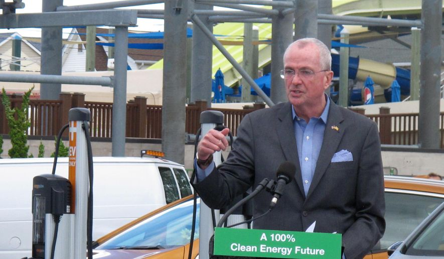 New Jersey Gov. Phil Murphy speaks at a news conference in a parking lot in Seaside Heights, N.J., Friday, July 9, 2021, where four electric vehicle charging stations were recently installed. The governor signed a package of clean energy bills aimed at making it easier for solar projects and electric vehicle charging stations. (AP Photo/Wayne Parry) ** FILE **
