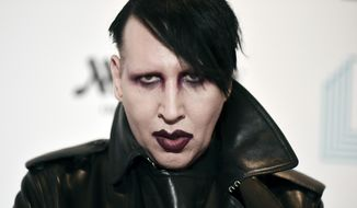 """In this Dec. 10, 2019, file photo, Marilyn Manson attends the 9th annual """"Home for the Holidays"""" benefit concert in Los Angeles. (Photo by Richard Shotwell/Invision/AP, File)"""