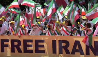 People attend a protest rally in Berlin, Germany, Saturday, July 10, 2021 as part of the 'Free Iran World Summit 2021'. (AP Photo/Michael Sohn)