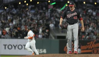 San Francisco Giants' Darin Ruf, background left, rounds the bases after hitting a solo home against Washington Nationals relief pitcher Sam Clay (49) during the fifth inning of a baseball game Friday, July 9, 2021, in San Francisco. (AP Photo/Tony Avelar)