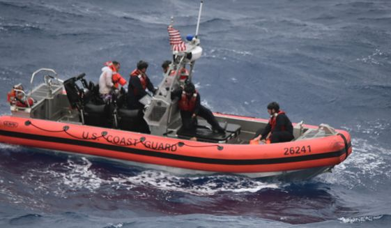 Crew Members from the Coast Guard Cutter Thetis rescued 13 people in the water 32 miles southeast of Key West, Fla., on Tuesday, July  6, after their boat capsized during the approach of Tropical Storm Elsa.  (U.S. Coast Guard via AP)