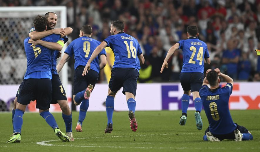 Italy players celebrate end of the Euro 2020 soccer final match between England and Italy at Wembley stadium in London, Sunday, July 11, 2021. (Andy Rain/Pool Photo via AP)