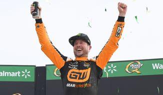 Kurt Busch celebrates in Victory Lane after winning a NASCAR Cup Series auto race, Sunday, July, 11, 2021, in Hampton, Ga. (AP Photo/John Amis)