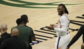 Phoenix Suns' Jae Crowder reacts as he talks with members of the Milwaukee Bucks bench during the second half of Game 3 of basketball's NBA Finals, Sunday, July 11, 2021, in Milwaukee. (AP Photo/Aaron Gash) **FILE**