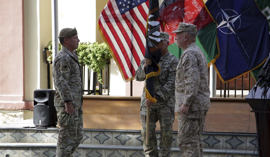 """U.S. Army Gen. Scott Miller, the top U.S. commander in Afghanistan, left, hands over his command to Marine Gen. Frank McKenzie, the head of U.S. Central Command, right, at a ceremony at Resolute Support headquarters, in Kabul, Afghanistan, Monday, July 12, 2021. The United States is a step closer to ending a 20-year military presence that became known as its """"forever war,"""" as Taliban insurgents continue to gain territory across the country. (AP Photo/Ahmad Seir)"""