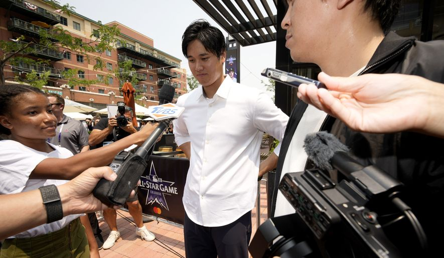 Shohei Ohtani, of the Los Angeles Angeles, larrives to a news conference to be named the American League's starting pitcher for the MLB All-Star baseball game, Monday, July 12, 2021, in Denver. (AP Photo/David Zalubowski)