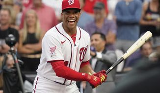 National League's Juan Soto, of the Washington Nationals, laughs during the first round of the MLB All Star baseball Home Run Derby, Monday, July 12, 2021, in Denver. (AP Photo/Gabriel Christus)