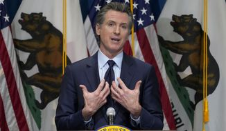 In this Jan. 8, 2021, file photo, California Gov. Gavin Newsom gestures during a news conference in Sacramento, Calif. Sacramento County Superior Court Judge James Arguelles ruled Monday July 12, 2021, that Newsom cannot belatedly put his Democratic Party affiliation next to his name on the ballot California voters will see when they decide if he should be removed from office in the Sept.14 recall election. (AP Photo/Rich Pedroncelli, Pool, File)