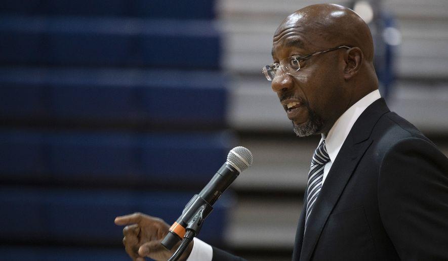 Sen. Raphael Warnock, D-Ga., speaks at Alfred E. Beach High School in Savannah, Ga., Thursday, July 8, 2021. (Jim Watson/Pool via AP) ** FILE **