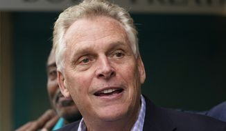 Democratic gubernatorial candidate, former Gov. Terry McAuliffe, greets supporters during a tour of downtown Petersburg, Va., Saturday, May 29, 2021. Republican gubernatorial nominee Glenn Youngkin's campaign announced Monday, July 12, 2021 that the political newcomer would not debate McAuliffe at a perennial event hosted by the state bar association, in part because of the journalist moderator. (AP Photo/Steve Helber)