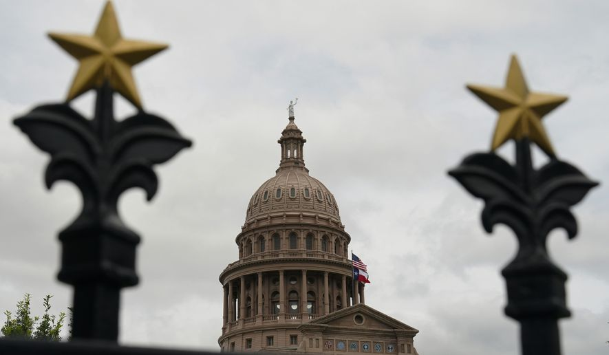 This June 1, 2021, photo shows the State Capitol in Austin, Texas. Democrats in the Texas Legislature are planning to leave the state in another revolt against a GOP overhaul of election laws. A person with knowledge of the decision told The Associated Press that Democrats are set to once again break quorum at the Texas Legislature in a dramatic showdown over voting rights in America. (AP Photo/Eric Gay) **FILE**