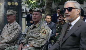 """U.S. Army Gen. Scott Miller, the top U.S. commander in Afghanistan, center, Marine Gen. Frank McKenzie, the head of U.S. Central Command, left, and Abdullah Abdullah, head of Afghanistan's National Reconciliation Council, right, attend at a ceremony where Miller relinquished his command, at Resolute Support headquarters, in Kabul, Afghanistan, Monday, July 12, 2021. The United States is a step closer to ending a 20-year military presence that became known as its """"forever war,"""" as Taliban insurgents continue to gain territory across the country. (AP Photo/Ahmad Seir)"""