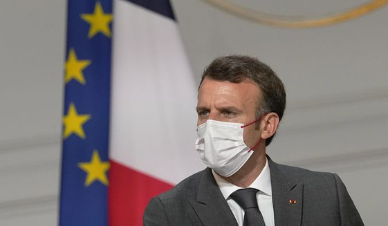 France's President Emmanuel Macron, meets French carmakers at the Elysee Palace in Paris, Monday, July 12, 2021. (AP Photo/Michel Euler, Pool)