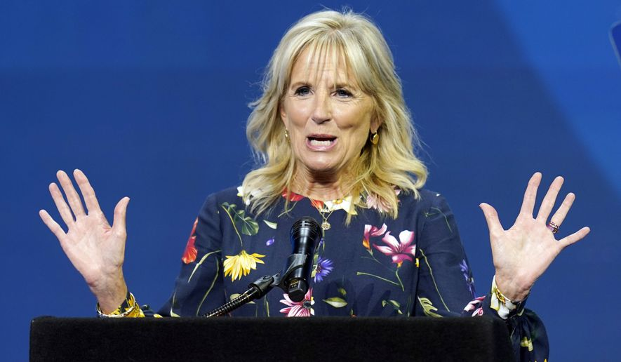 In this July 8, 2021 photo, first lady Jill Biden delivers remarks before the start of the finals of the 2021 Scripps National Spelling Bee at Disney World in Lake Buena Vista, Fla. Jill Biden will attend the opening ceremony of the Olympic Summer Games in Tokyo. The White House announced the trip Tuesday, even as the city has entered a new state of emergency over a rise in coronavirus cases.(AP Photo/John Raoux)