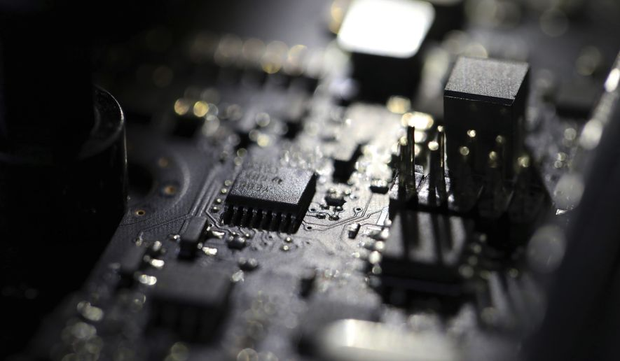 This Feb 23, 2019, file photo shows the inside of a computer. For 21 years, the software company Kaseya labored in relative obscurity, at least until cybercriminals exploited it in early July 2021 for a massive ransomware attack that snarled businesses around the world and escalated U.S.-Russia diplomatic tensions. (AP Photo/Jenny Kane, File)