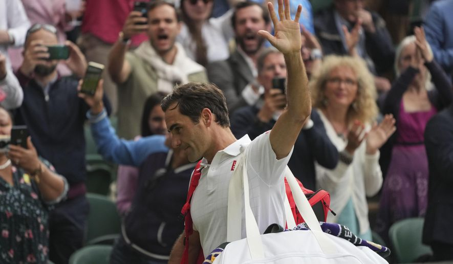 Switzerland's Roger Federer leaves the court after being defeated by Poland's Hubert Hurkacz during the men's singles quarterfinals match on day nine of the Wimbledon Tennis Championships in London, Wednesday, July 7, 2021. (AP Photo/Alberto Pezzali)