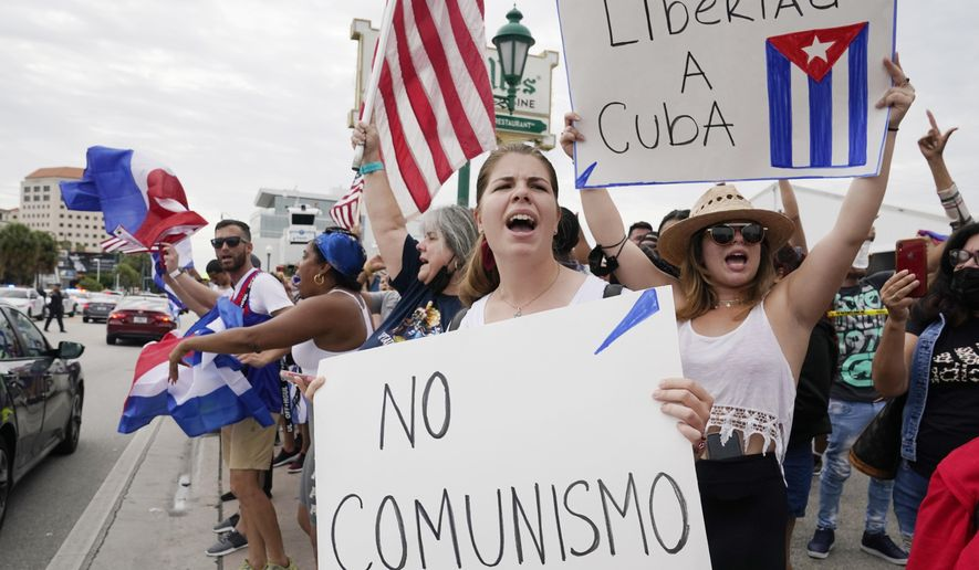 Cuban exiles rally at Versailles Restaurant in Miami's Little Havana neighborhood in support of protesters in Cuba, Monday, July 12, 2021, in Miami. Sunday's protests in Cuba marked some of the biggest displays of antigovernment sentiment in the tightly controlled country in years. (AP Photo/Marta Lavandier)