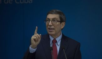 Cuba´s Foreign Minister Bruno Rodriguez speaks during a press conference in Havana, Cuba, Tuesday, July 13, 2021. Rodriguez spoke after a rare outpouring of weekend protests over high prices and food shortages in the island nation where little dissent against the government is tolerated. (Pool AP Photo/Ismael Francisco)