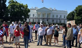 Emilio Fajardo, leader of MORE, a Cuban freedom group, urges the Biden administration to establish ties with Cuban protesters during a rally in front of the White House on July 13. (Jeff Mordock/The Washington Times)