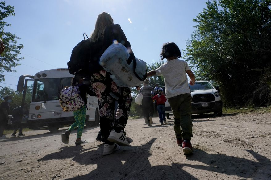 A migrant family from Venezuela move to a Border Patrol transport vehicle after they and other migrants crossed the U.S.-Mexico border and turned themselves in Del Rio, Texas. (AP Photo/Eric Gay, File)