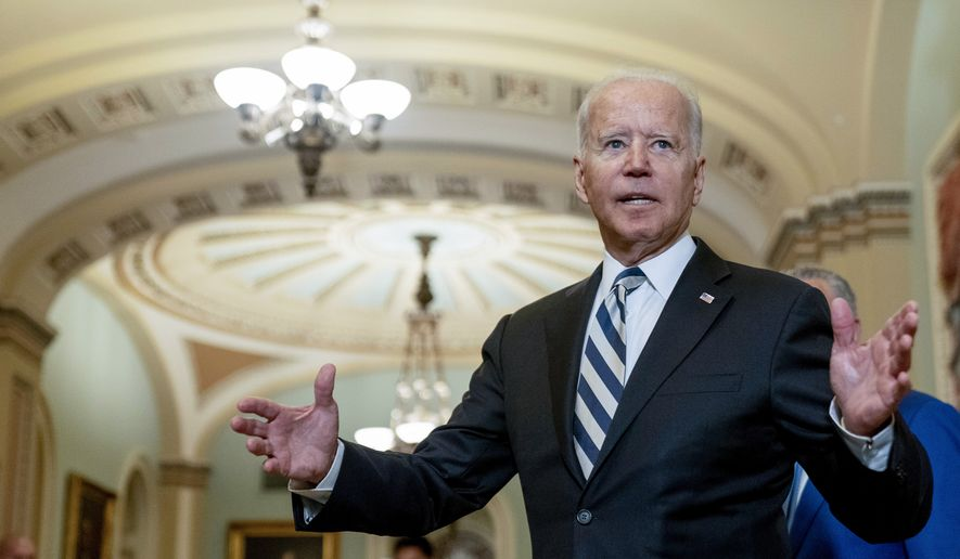 President Joe Biden speaks with members of the media after leaving a meeting with fellow Democrats at the Capitol in Washington, Wednesday, July 14, 2021, to discuss the latest progress on his infrastructure agenda. (AP Photo/Andrew Harnik)