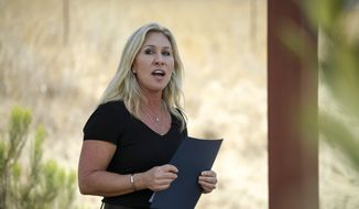 Rep. Marjorie Taylor Greene, R-Ga. speaks outside the Otay Mesa Detention Center after touring the facility Wednesday July 14, 2021, in San Diego. (AP Photo/Denis Poroy)