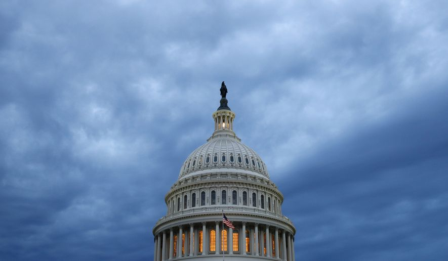 In this June 12, 2019, file photo, clouds roll over the U.S. Capitol dome as dusk approaches in Washington. The committee charged with helping Republicans wrest control of the House next year raised $45.4 million over the last three months, a record quarterly haul during a year without a national election. (AP Photo/Patrick Semansky, File)