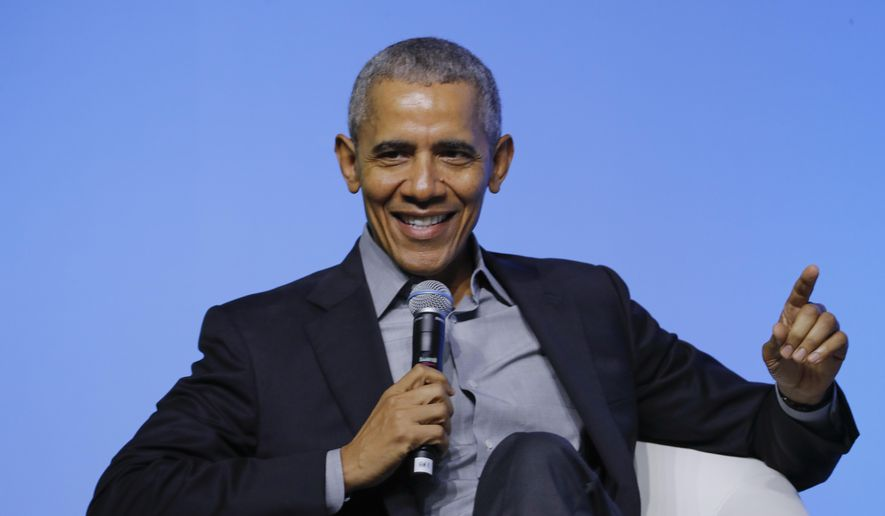 """Former U.S. President Barack Obama gesture as he attends the """"values-based leadership"""" during a plenary session of the Gathering of Rising Leaders in the Asia Pacific, organized by the Obama Foundation in Kuala Lumpur, Malaysia, on Dec. 13, 2019. (AP Photo/Vincent Thian) ** FILE **"""