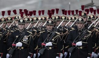 Members of the Republican Guard march in formation on the Champs Elysees prior to the Bastille Day parade in Paris, Wednesday July 14, 2021. Bastille Day is the French national holiday that commemorates the beginning of the French Revolution on July 14, 1789. (AP Photo/Lewis Joly)
