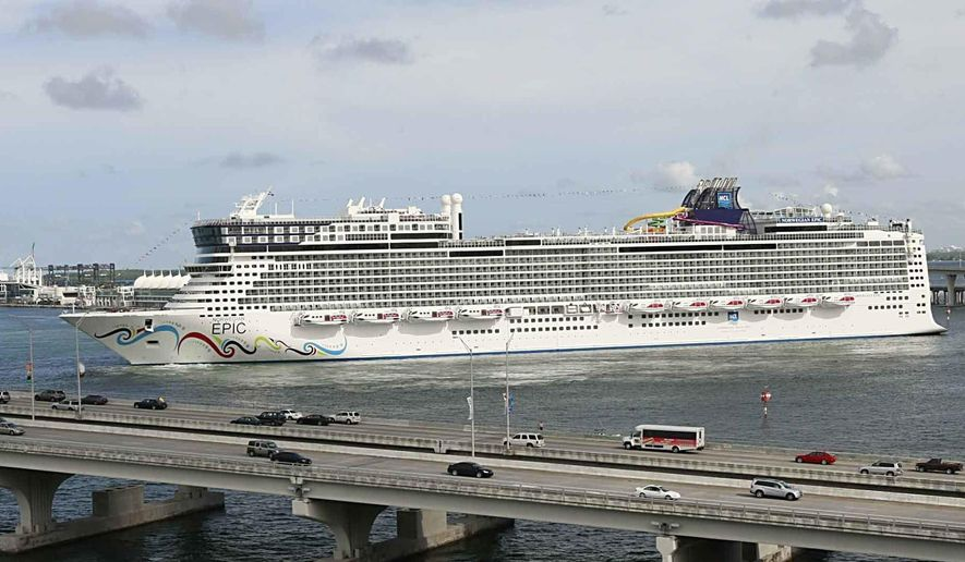 In this July 7, 2010, file photo, the Norwegian Epic, owned by the Norwegian Cruise Line Corporation, sails to the Port of Miami in Miami. Norwegian Cruise Line is challenging a new Florida law that prevents cruise companies from requiring passengers to show proof of vaccination against the COVID-19 virus. The lawsuit, filed Tuesday, July 13, 2021, in Miami federal court, contends that the law jeopardizes safe operation of cruise ships by increasing risk of contracting the virus. Norwegian intends to restart cruises from Florida ports Aug. 15 with vaccinations required for all passengers. (Pedro Portal/El Nuevo Herald via AP, File)
