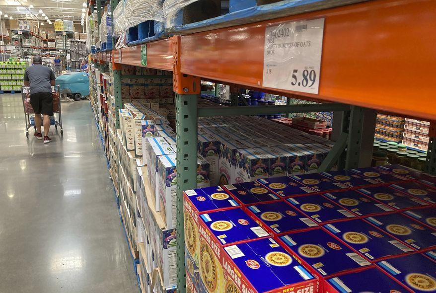 A shopper surveys the cereals in a Costco warehouse on Thursday, June 17, in Lone Tree, Colo. (AP Photo/David Zalubowski)