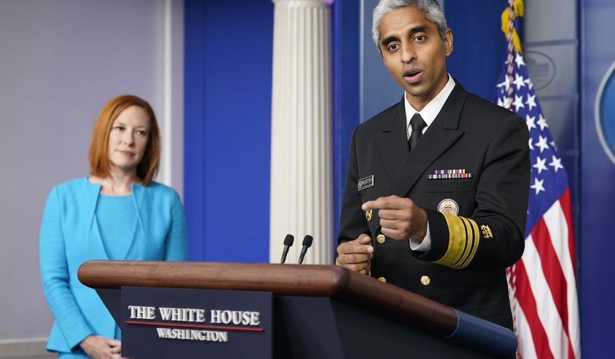 Surgeon General Dr. Vivek Murthy speaks during the daily briefing at the White House in Washington, Thursday, July 15, 2021. White House press secretary Jen Psaki listens at left. (AP Photo/Susan Walsh)