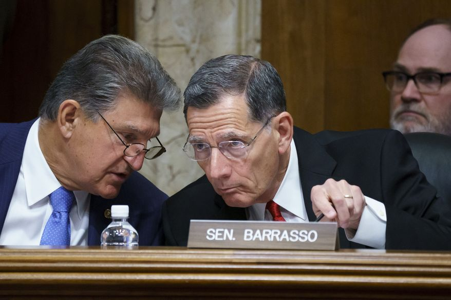 In this June 23, 2021, file photo, Sen. Joe Manchin, D-W.Va., chair of the Senate Energy and Natural Resources Committee holds a hearing with Ranking Member Sen. John Barrasso, R-Wyo., right, at the Capitol in Washington. (AP Photo/J. Scott Applewhite, File)