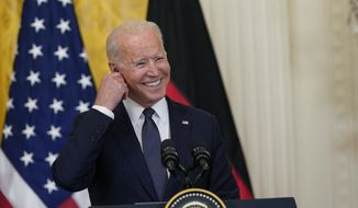 President Joe Biden smiles during a news conference with German Chancellor Angela Merkel in the East Room of the White House in Washington, Thursday, July 15, 2021. (AP Photo/Susan Walsh)